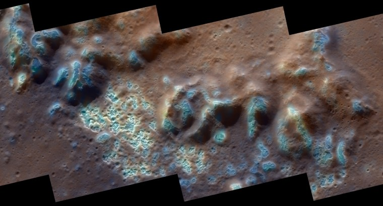 """This image from NASA's messenger probe provides a spectacular view of the """"hollows"""" on Mercury's surface — depressions that may have been formed by the removal of volatile-containing material exposed within impact craters. Shown here is an interior portion of the floor and peak-ring mountains of the Raditladi impact basin."""