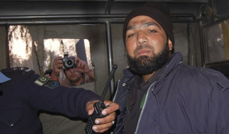 Image: File photo shows Qadri, a bodyguard of Punjab governor Taseer, after being detained at the site of Taseer's shooting in Islamabad