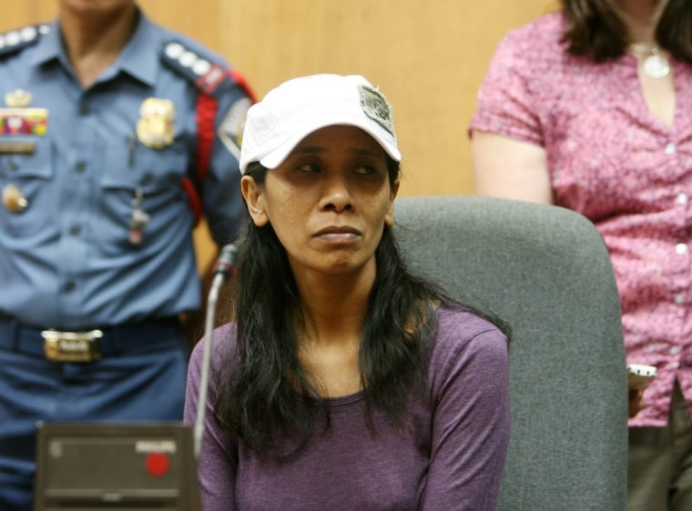 Image: Released American kidnap victim Gerfa Yeatts Lunsmann, 50, listens during a press conference in Zamboanga City