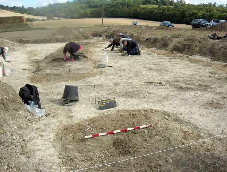 Archaeologists excavate the site of a prehistoric teen girl's grave in Kent, England.