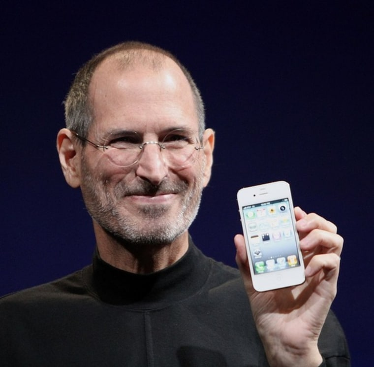 Steve Jobs, who died Wednesday, holds up a white iPhone 4 at the 2010 Worldwide Developers Conference.