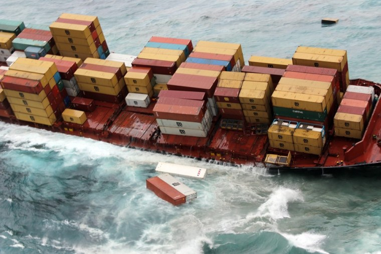 Image: The stricken cargo vessel Rena losing containers as heavy swells wash her deck