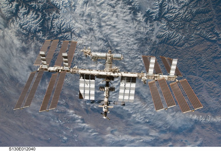 With Earth's ruggedterrain as a backdrop, the International Space Station is featured in this image from an STS-130 crew member on space shuttle Endeavour after the station and shuttle began their post-undocking relative separation.