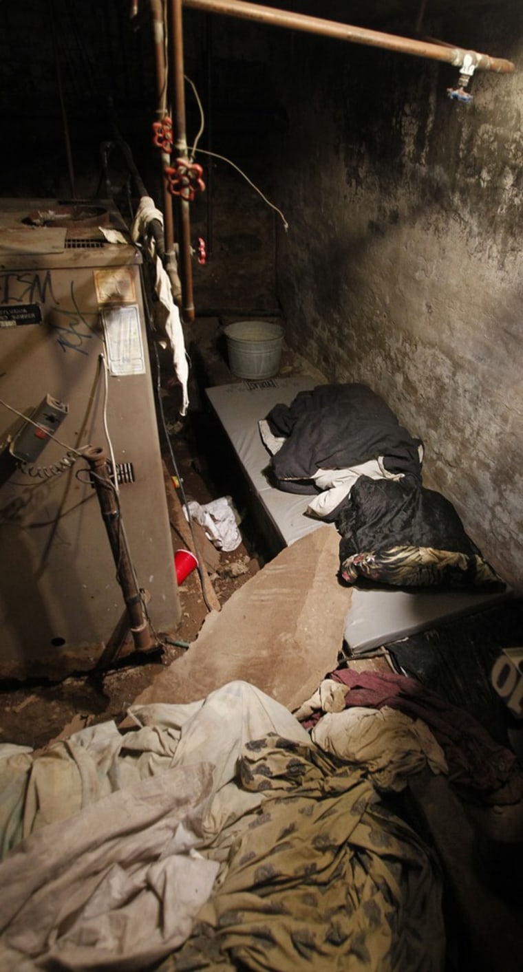 Image: The dank sub-basement room in Philadelphia where four weak and malnourished mentally disabled adults, one chained to the boiler, were found locked inside on Saturday