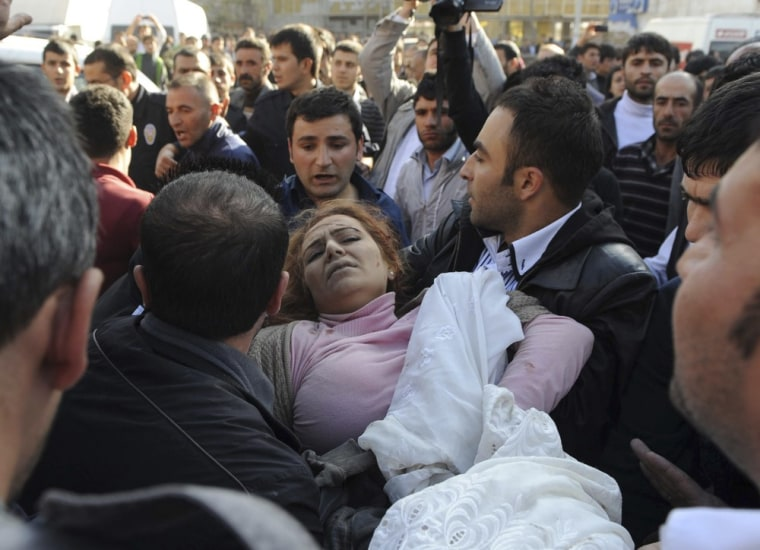 Image: A survivor is carried to the ambulance after an earthquake in Tabanli village near the eastern Turkish city of Van