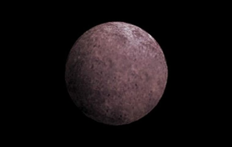 This artist's conception shows 2007 OR10, nicknamed Snow White. Astronomers suspect that its rosy color is due to the presence of irradiated methane.