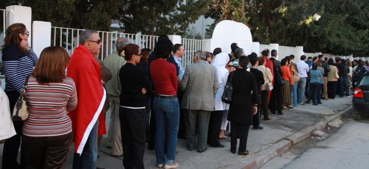 Image: Tunisians wait to vote in Menzeh