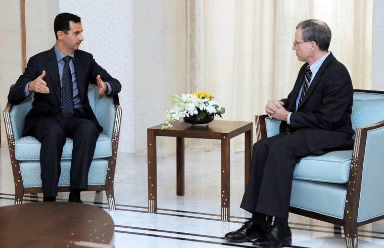 Image: US ambassador Robert Ford, right with Syrian President Bashar Assad in Janurary.