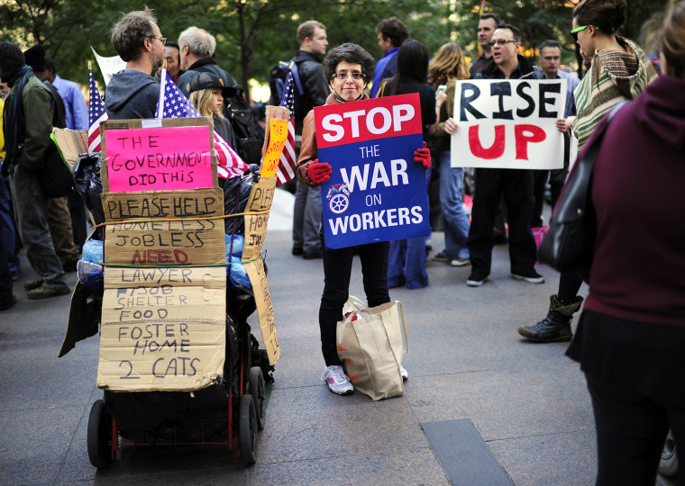 Image: Occupy Wall Street members display placards on Zuccotti Park