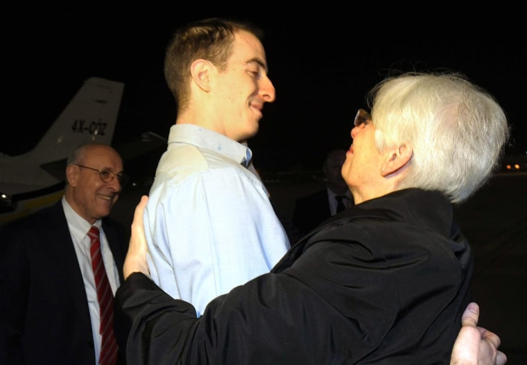 Image:  Ilan Grapel (C), a US-Israeli citizen accused of spying in Egypt, hugging his mother Irene