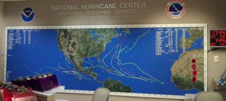 The big board inside the National Hurricane Center keeps tabs on the year's storms.
