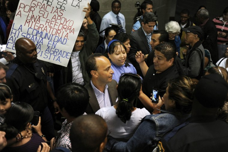 Image: Opponents of Alabama immigration law stage rally at Fair Park Arena