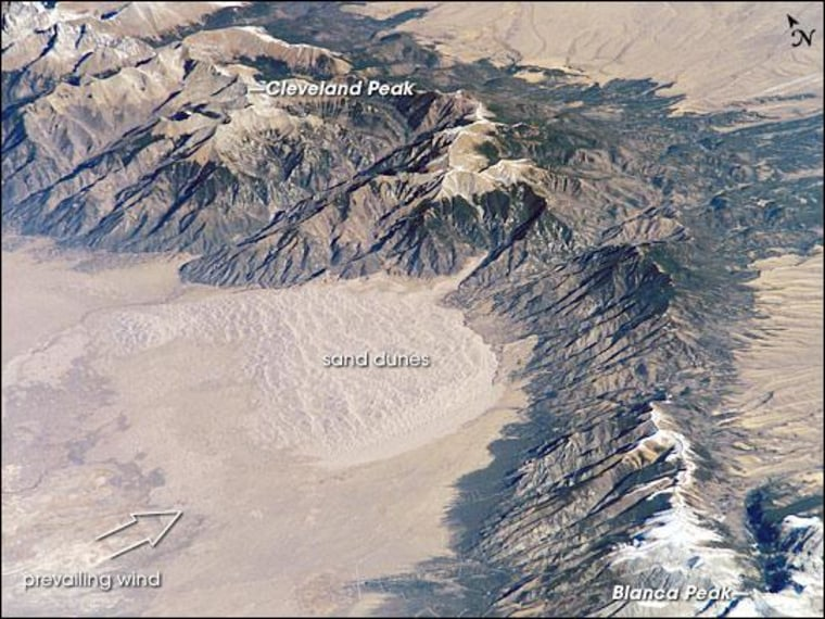 The Sangre de Cristo Mountains of south-central Colorado stretch dramatically from top left to lower right of this astronaut photograph.