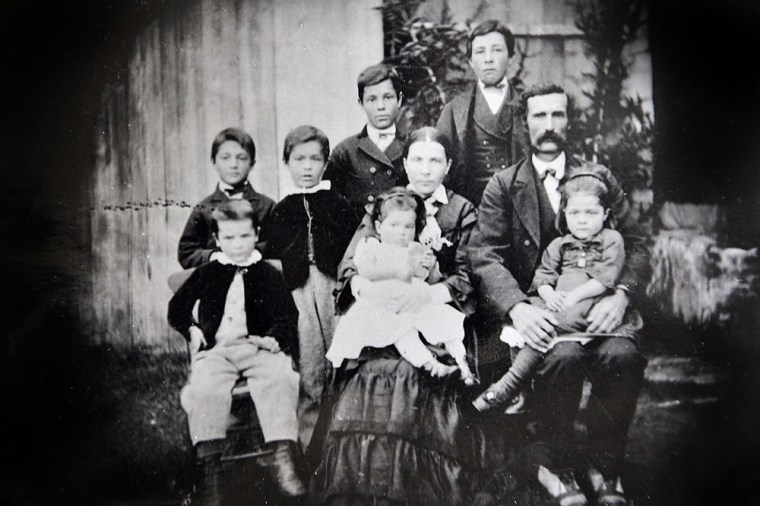 Achille Bhérer and Hortense Gaudreault photographed in 1876 in Charlevoix with seven of their 14 children.