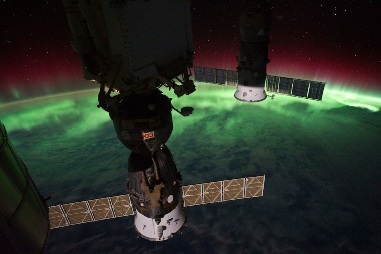 """Astronaut Ron Garan tweeted this photo by fellow spaceflyer Mike Fossum (@astro_aggie) on Oct. 5,showing auroral glow over Earth. He wrote: """"@Astro_Aggie is changing the way us earthlings view our planet. Great snap Mike! #ISS #NASA."""""""