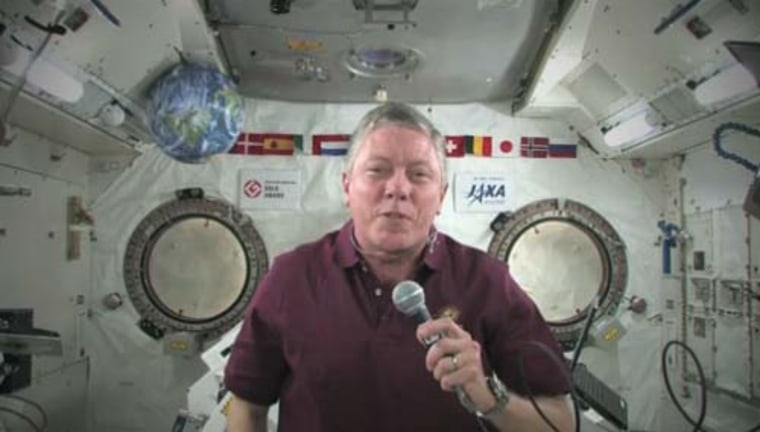 NASA astronaut Mike Fossum, commander of the Expedition 29 crew on the International Space Station, offers a video tribute to armed servicemen and women for U.S. Veterans Day on Friday.