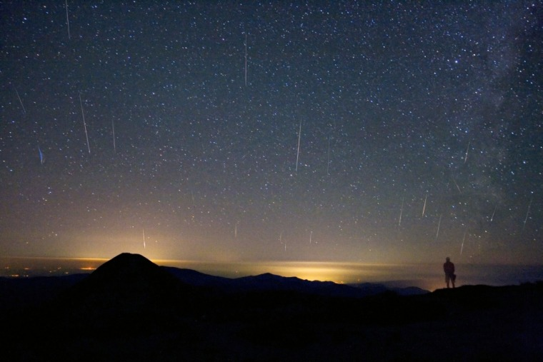 A mountain top above the clouds andlights of Romania served as a good spot for astrophotographer Alex Tudorica to watch the 2008 Perseid meteor shower. This composite picture from one of the highest points in Romania, the Omu summitin the Southern Carpathian Mountains, caught about 20 of the shower's bright streaks.