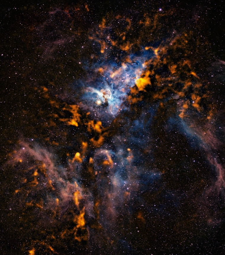 A new image of the Carina nebula reveals the cold, dusty clouds from which stars form in the bustling stellar nursery.