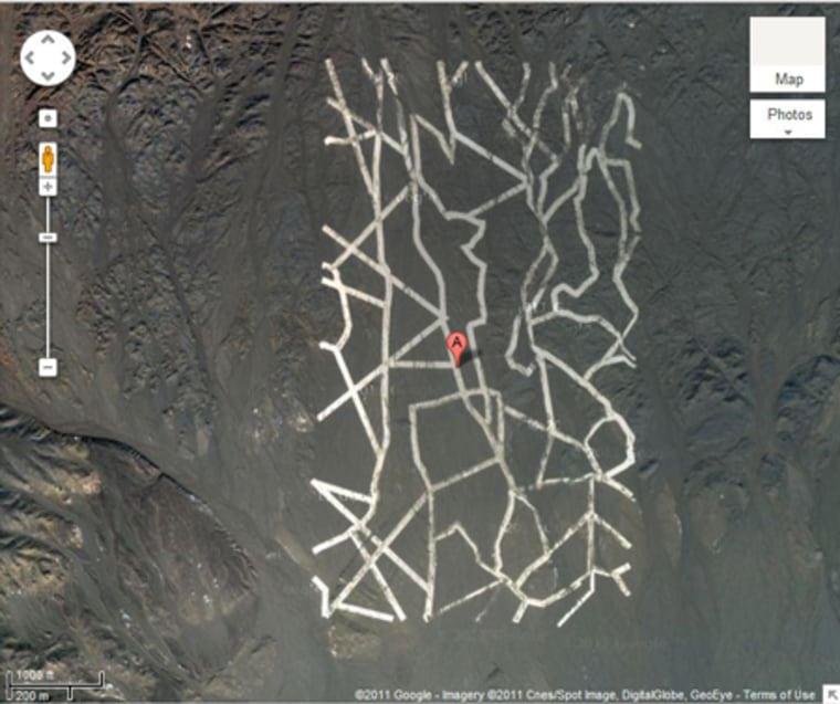 A strange zigzag pattern in the Gobi Desert in China. Coordinates: 40.452107,93.742118.