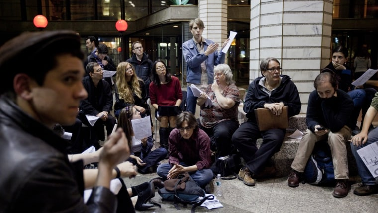 """Image: People listens as ideas are presented to a gathering of Occupy Wall Street demonstrators at the """"demands working group,"""" held in the atrium of 60 Wall Street in New York City on Tuesday, November 8, 2011."""