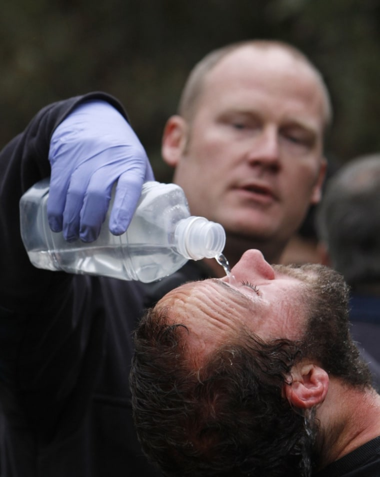 Image: University of California, Davis, student Mike Fetterman, receives a  treatment for pepper spray