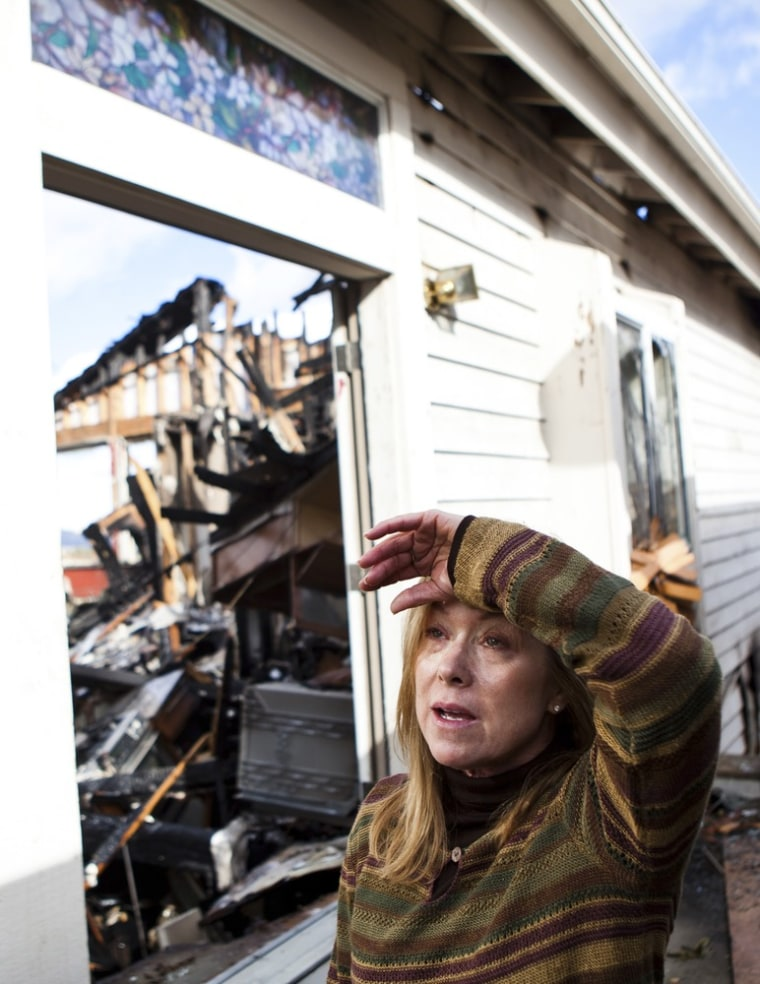 Image: Joelle Greene reacts as she views the remains of her burned home in Reno