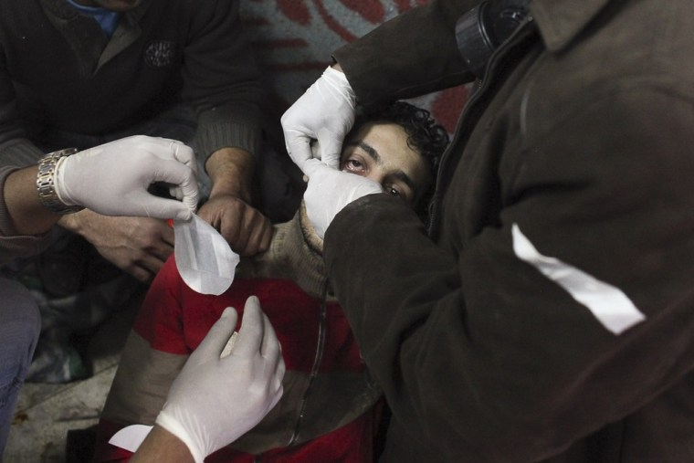 Image: A protester is treated for injuries sustained during clashes with Egyptian riot police