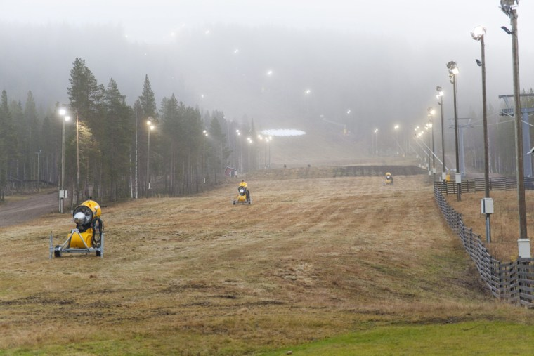 A grassy, snowless, ski slope is seen in Levi, Finland.