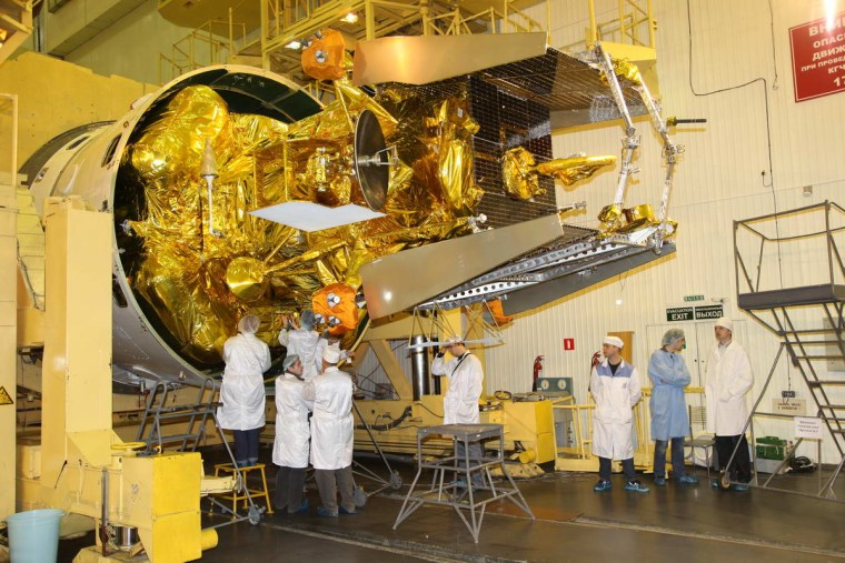 Russian space engineers seal the Mars Phobos-Grunt spacecraft inside its Zenit 3SL rocket nose cone before its November launch to explore Mars and its moon Phobos.