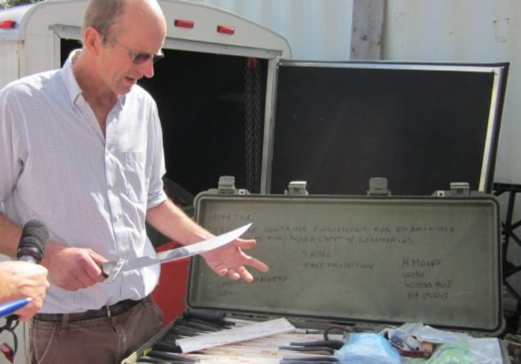 Michael Moore, a veterinarian and whale biologist at the Woods Hole Oceanographic Institution, displays the contents of his portable whale necropsy kit.