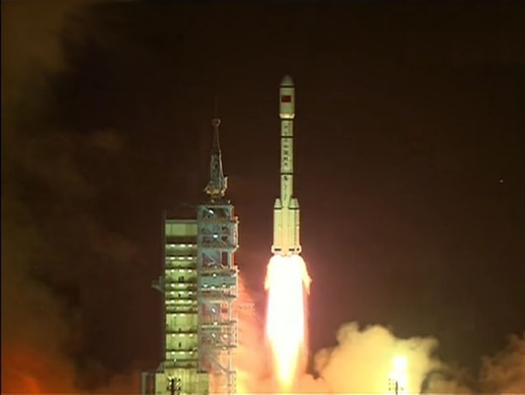 "China's first space laboratory module, Tiangong 1 (Chinese for ""Heavenly Palace"") blasts off from the Jiuquan Satellite Launch Center on Sept. 29. The module will fly a two-year mission for docking tests."
