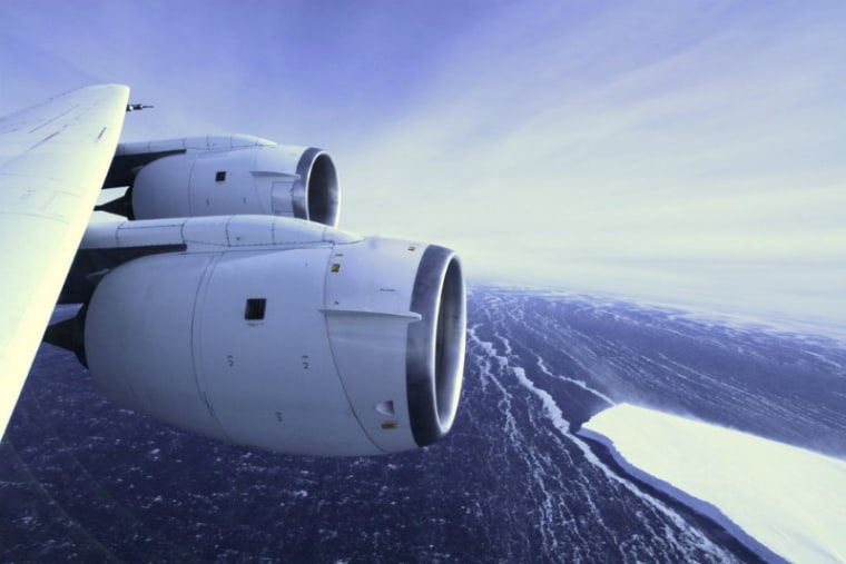 A NASA aircraft, part of the agency's IceBridge mission, banks over an ice shelf jutting out from western Antarctica during an October 2011 data-gathering flight.