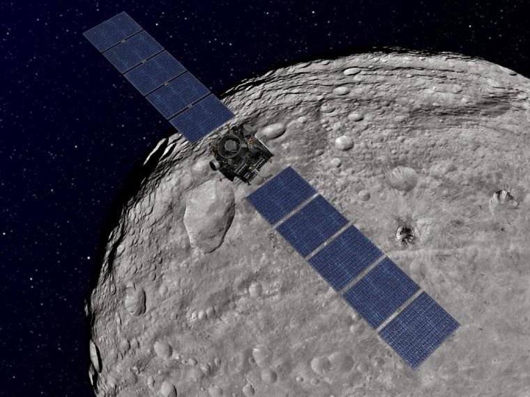 This artist's concept shows NASA's Dawn spacecraft orbiting the giant asteroid Vesta.