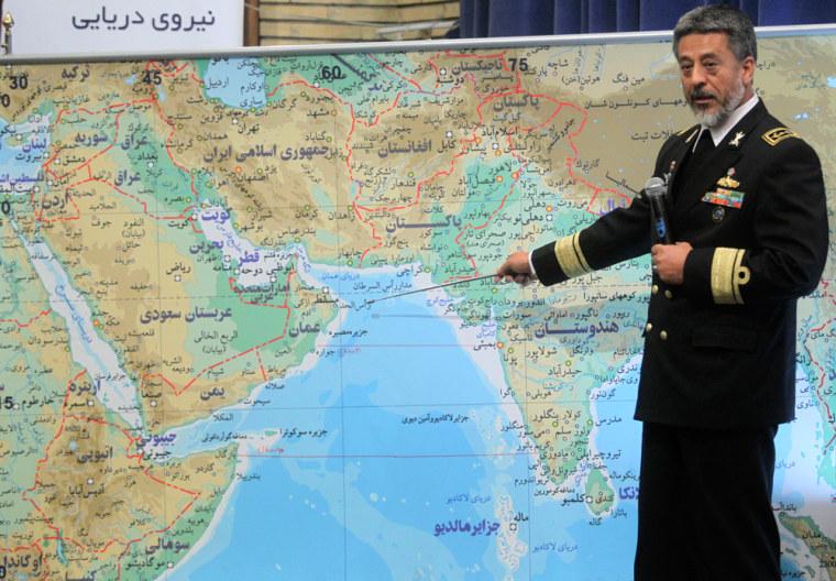 Image: Iran's Navy Commander Sayari points at a map during a news conference in Tehran