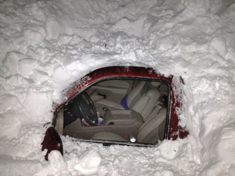 Image: car in snowdrift after Texas family was rescued