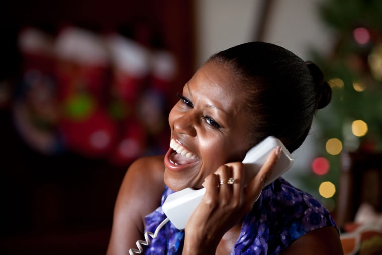 First Lady Michelle Obama talksto a childSaturday as part of the annual NORAD Tracks Santa program. Mrs. Obama answered the phone calls from Kailua, Hawaii.