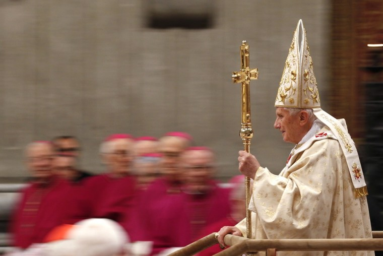 Image: Pope Benedict XVI arrives to lead the Christmas mass in Saint Peter's Basilica at the Vatican