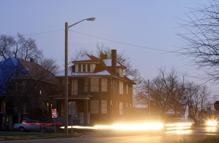 Image: A lone streetlight, one that survived the mass removal of streetlights this year to save the city money, in Highland Park, Mich.