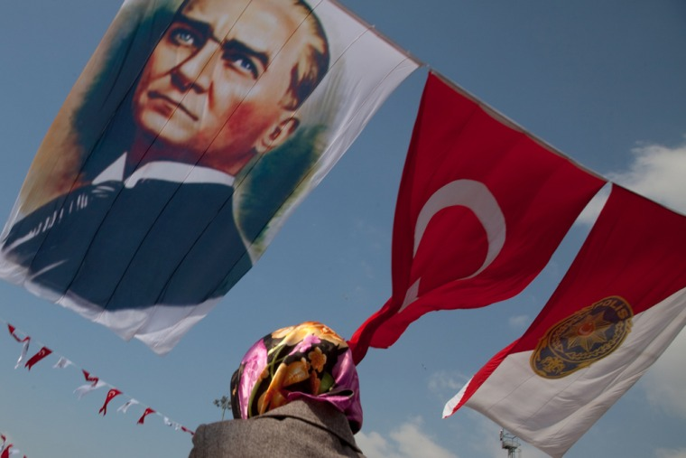 A Turkish flag and one emblazoned with the face of Mustafa Kemal Ataturk wave in Istanbul's Taksim Square. When the Ottoman Empire crumbled after the First World War, Ataturk defeated the Allies and worked to establish a Westernized and strictly secular state. The founder of the Turkish Republic is still adored by many and his likeness is widely on display throughout the country.
