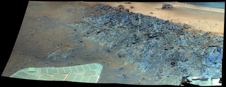 NASA's Opportunity rover will spend the Martian winter of 2012 atGreeley Haven, shown here in a false-color view to emphasize differences in composition. The rocks of Greeley Haven stand out in blue-gray tints; in the background at right lies a tan patch of sand.
