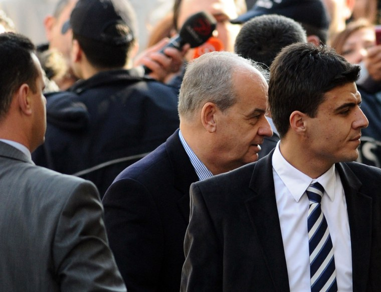 Image: Former Chief of General Staff, General Ilker Basbug (C), arrives at a courthouse in Istanbul on January 5