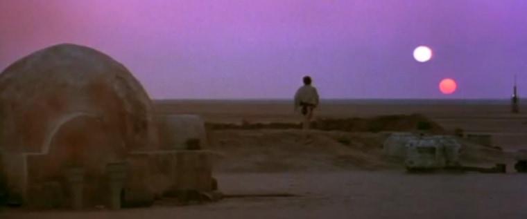 """A shot from """"Star Wars Episode IV: A New Hope"""" showing sunset on the planet Tatooine."""