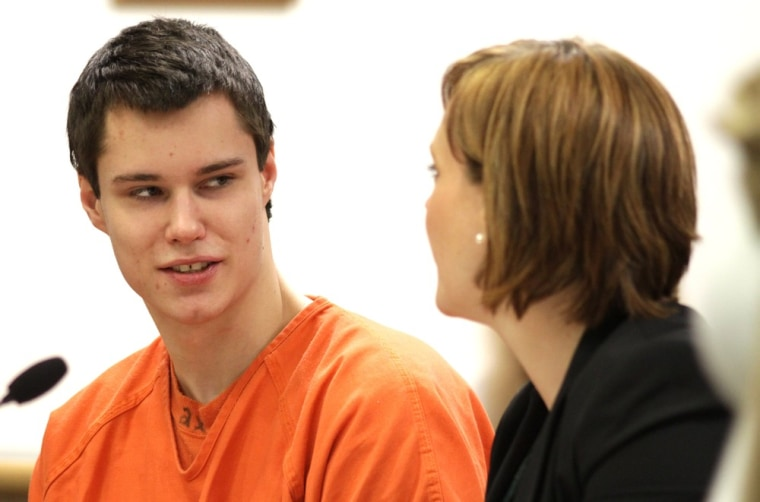 Image: Colton Harris-Moore, the Barefoot Bandit, talks with one of his lawyers at his sentencing in Island Superior Court in Coupeville