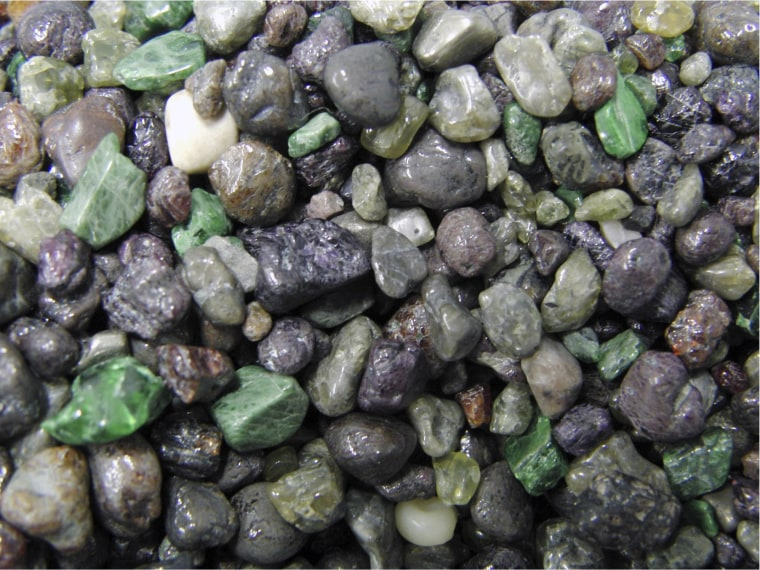 Diamond indicator mineral grains recovered during mining of Canadian kimberlite; minerals are sourced from the deep mantle and are rapidly transported to the Earth's surface by kimberlite magma.