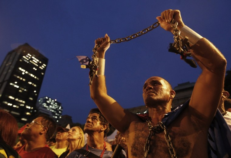 Image: Brazilian police, firefighters and prison guards protest during a rally in Rio de Janeiro.