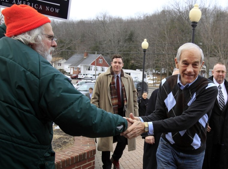 Image: Republican presidential candidate Paul greets voters outside a Republican Caucus in Sanford