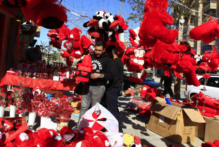 Image: A man shops for Valentine's Day gifts in Baghdad, Iraq