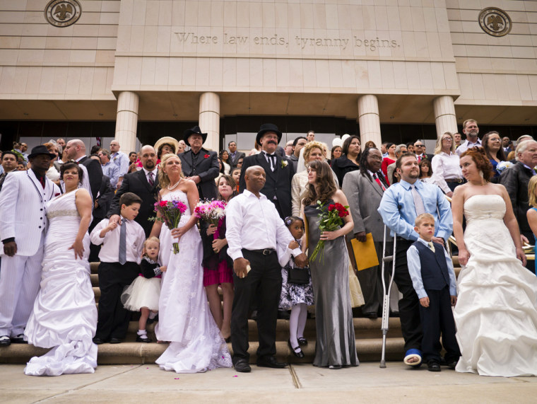Image: 96 couples gather on the steps of the Arizona Supreme Court for their mass wedding ceremony on Valentine's Day in Phoenix