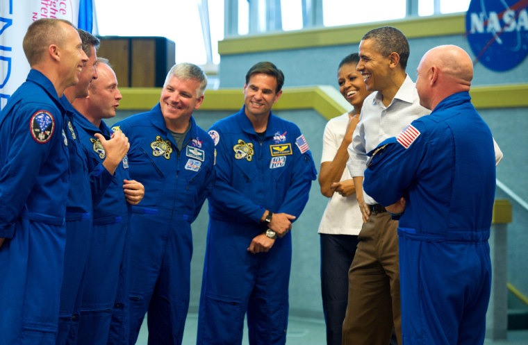 President Barack Obama and first lady Michelle Obama share a laugh with STS-134 space shuttle Endeavor commander Mark Kelly (with back to camera), right, and shuttle astronauts, from left, Andrew Feustel, European Space Agency's Roberto Vittori, Michael Fincke, Gregory H. Johnson, and Greg Chamitoff, after their launch was scrubbed on April 29, 2011, at Kennedy Space Center in Cape Canaveral, Fla.