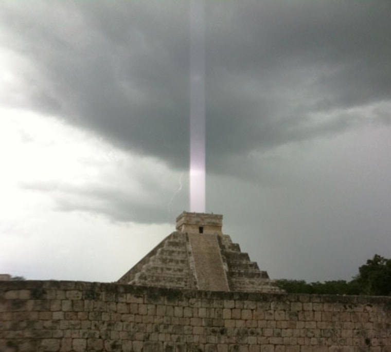 """""""El Castillo,"""" a Mayan temple on the Yucatan Peninsula in Mexico, with a mysterious """"light beam"""" emerging from the top."""